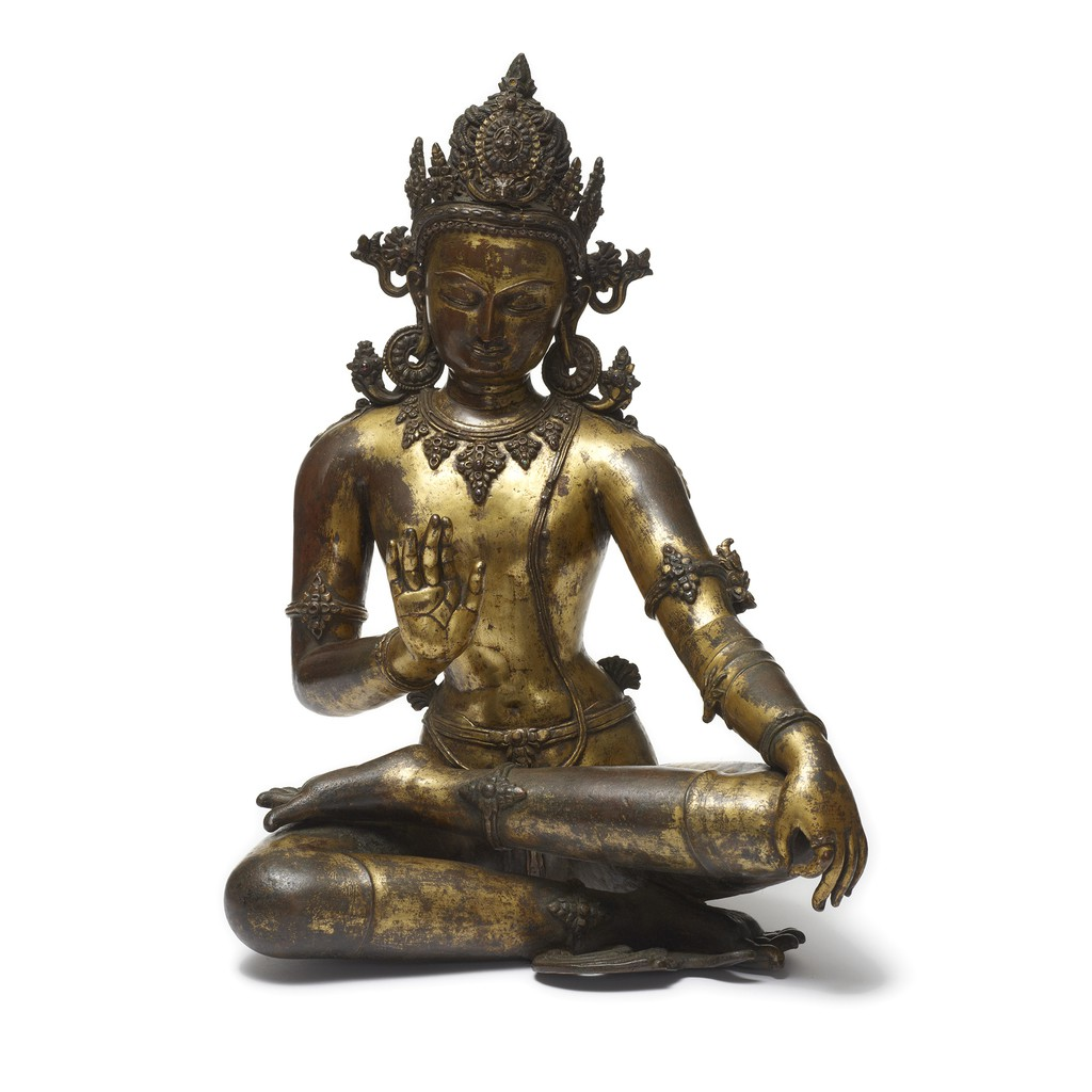 This Bodhisattva sculpture, seated in a relaxed posture, makes the gesture of reassurance with his right hand and the gesture of teaching with his left.