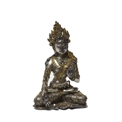 A White Tara sculpture in a seated pose and her hands makes the White Tara hand gestures.