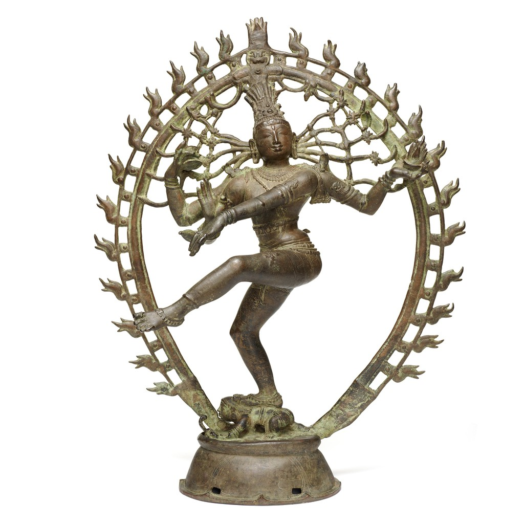 A copper alloy Shiva as Lord of the Dance sculpture shows a Shiva is dancing , his four hands are in different gestures.