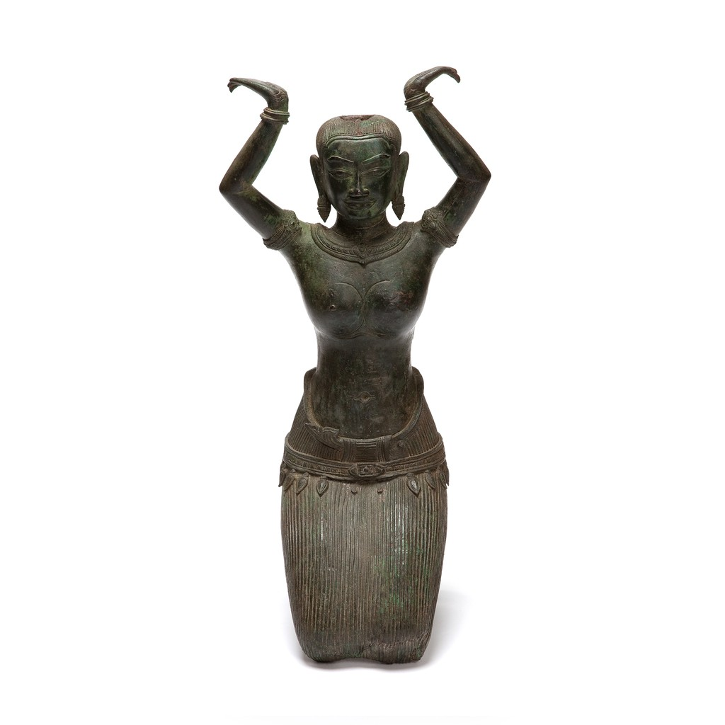 A copper alloy kneeling woman is put her hands up seems like she is supposed to hold something on her  head.