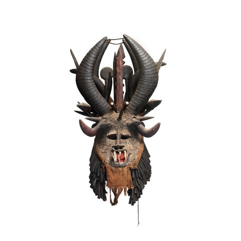 A mask which presents a face between monster and human. It has fangs and horns.