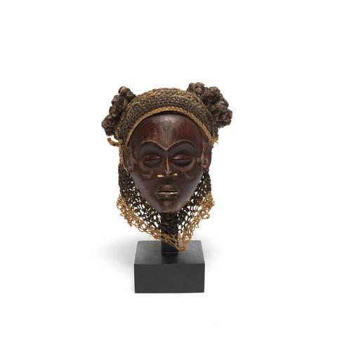 A wooden female head portrait.