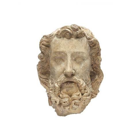 A head sculpture of a man who has dense beard and curve hair. He is looking forward and his mouth is slightly open.