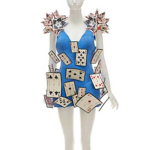 A blue dress which is decorated by poker cards.