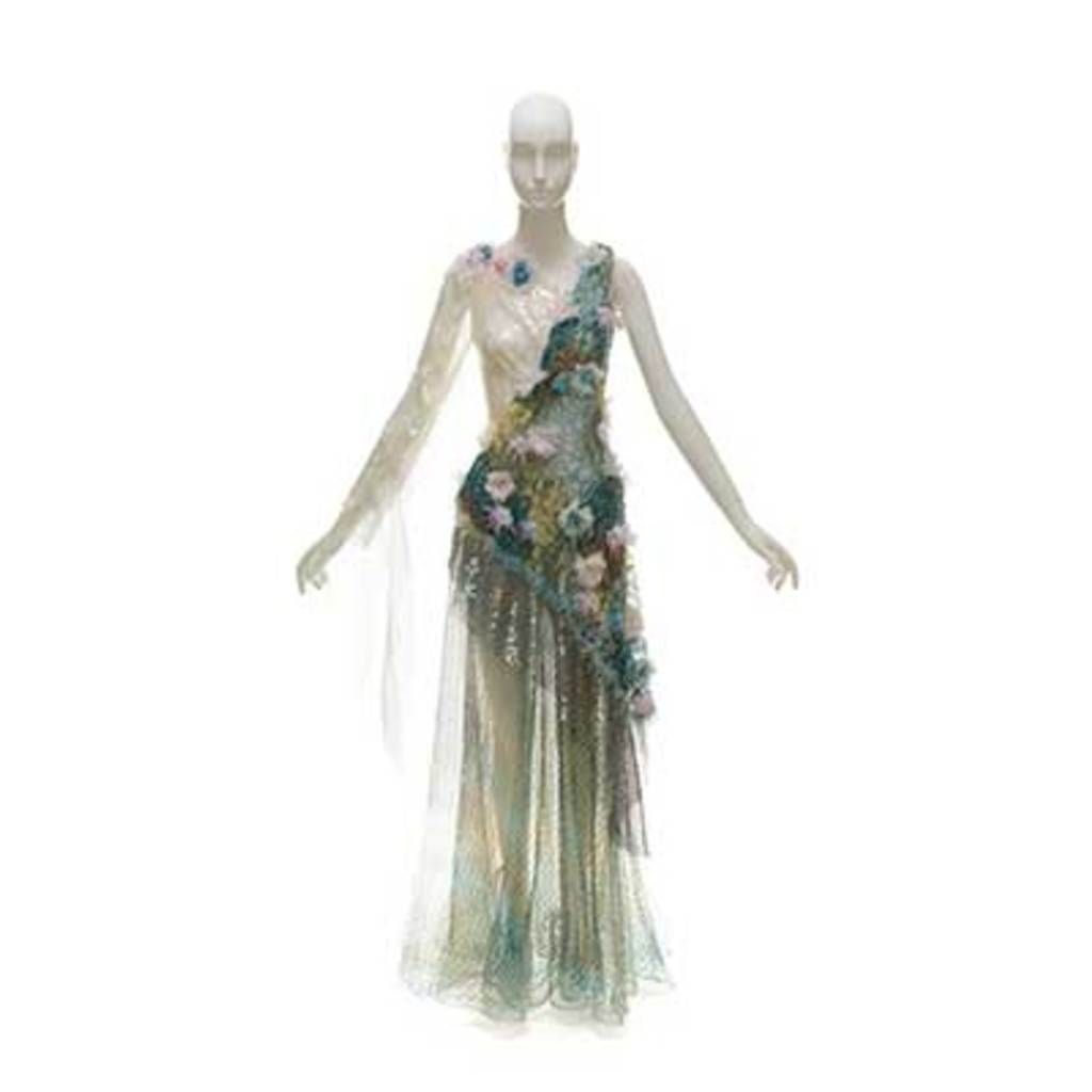 A green long dress with flowers and sequins decoration. The skirt part looks like a fish tail shape.