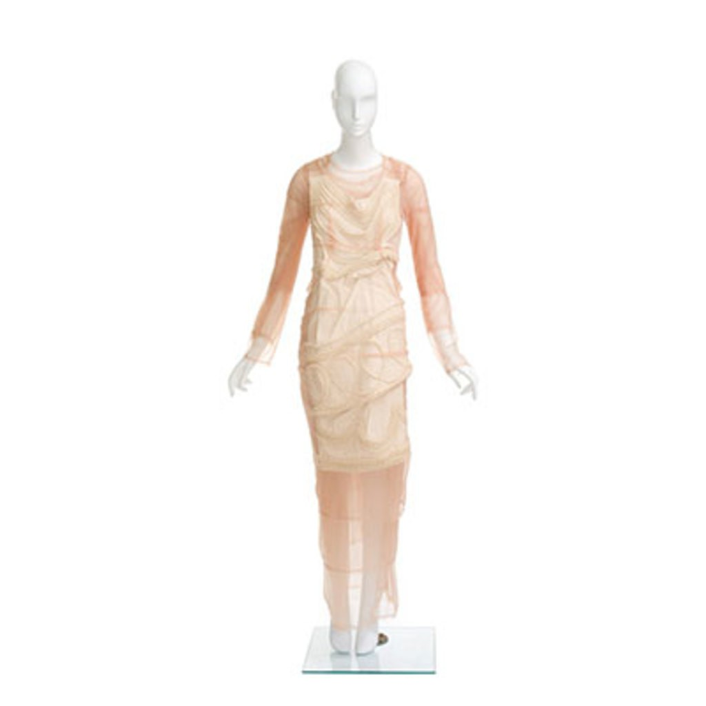A pink Comme des Garçons dress. In the front of this dress, here's another smaller white dress which is covering the pink dress.
