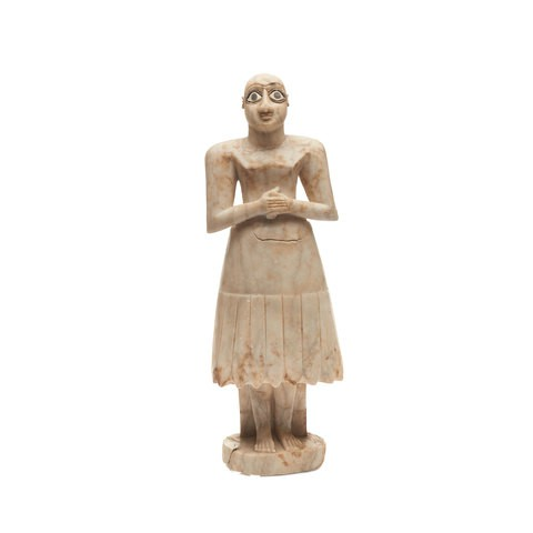 A gypsum sumerian statuette is standing and putting his hands in front.
