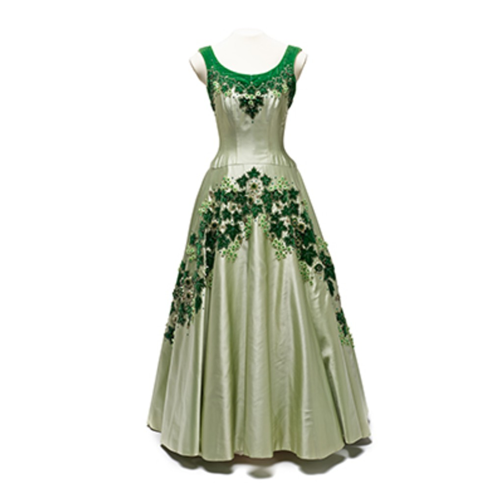 A green dress with green plants pattern which are made from crystals and emeralds.