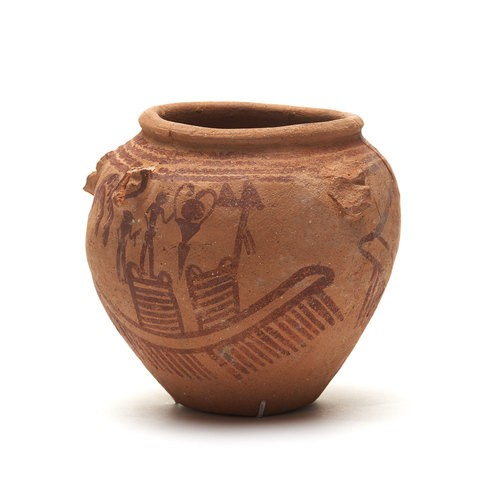 A clay Predynastic Vessel. The jar painted with a scene of a boat, a dancing woman, and two men.