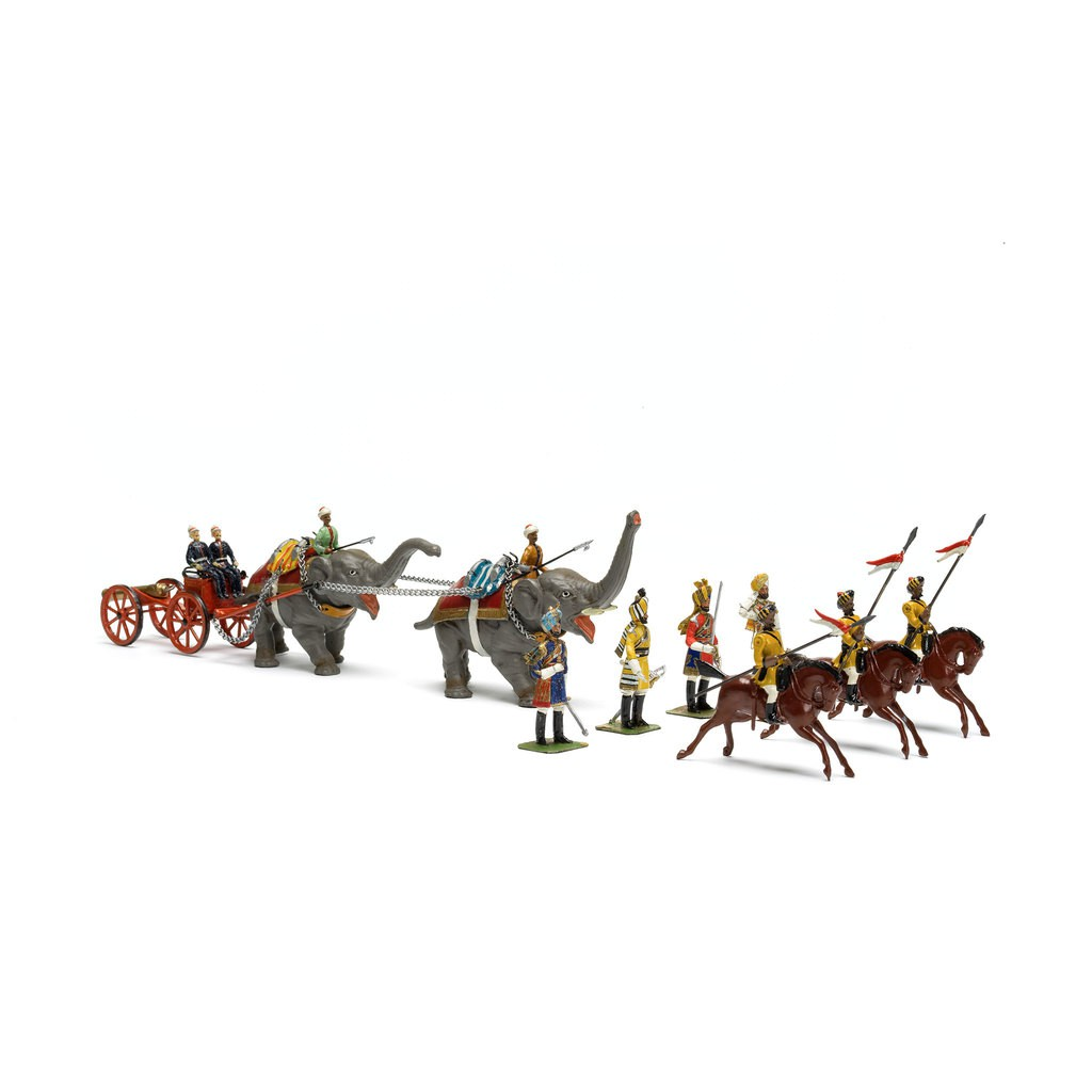 A group of small sculptures which presents the cavalry with elephants & canon. There are three horses, two elephents and eleven Indian soldiers in the set.