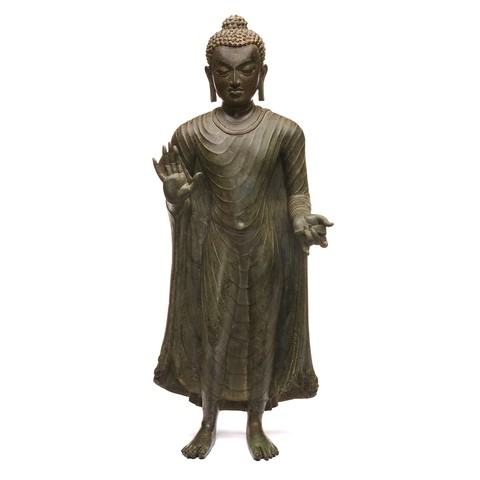 The Copper alloy Buddha is standing with it's iconic hand gestures.