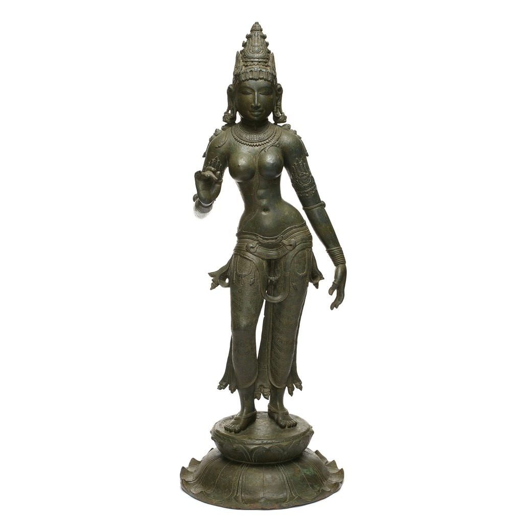 A Parvati is standing on a lotus-shape stand. She put her right hand up with a special gesture.