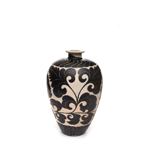 A light brown stoneware bottle  with black flowers pattern on it.