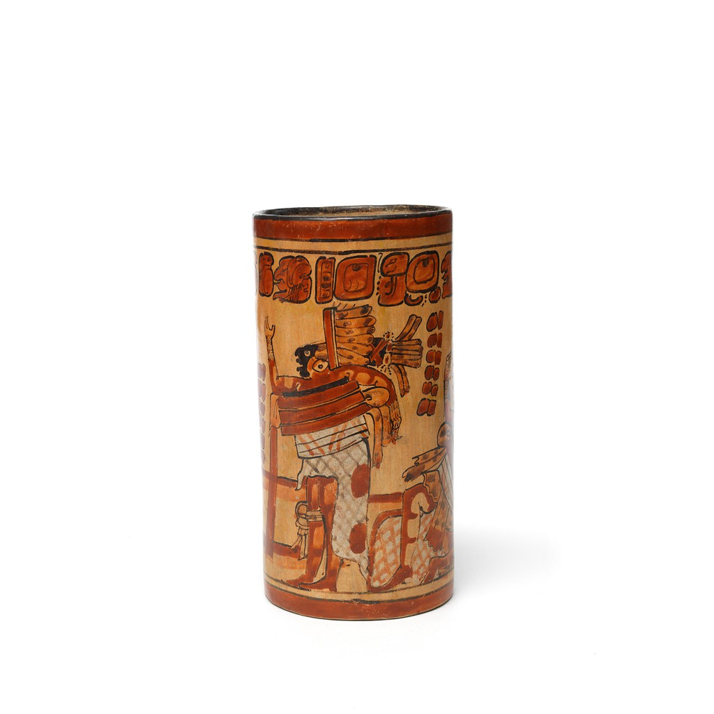 A earthenware cylinder vase with yellow and brown ballgame scene pattern on it.