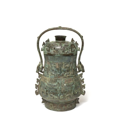 "A bronze wine vessel with six mythical animal ""Taotie""s' faces on it."