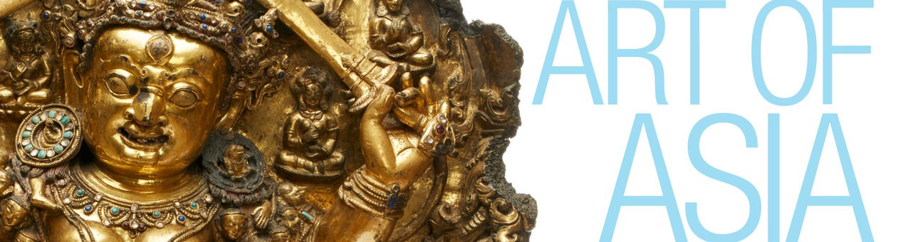 """A close view of Buddha sculpture. The collection title """"Art of Asia"""" is beside it."""