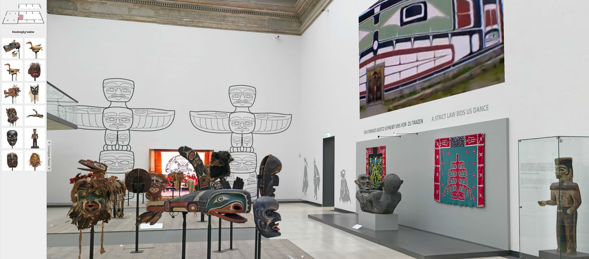 An Kwakwaka'wakw exhibition in Staatliche Kunstsammlungen Dresden. There are multiple Kwak´wala masks and mural in the bright gallery room.
