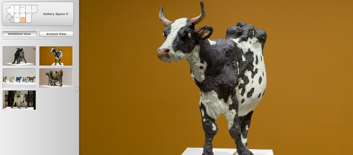 """The landing page of the Joe Fafard Exhibition. A clay cow sculpture made by Fafard is on the right. The Title """"Joe Fafard"""" is on the left top. Below it, there are French and English introduction and enter buttons."""